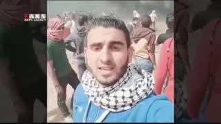 فیلم فوقالعاده از قرآن خواندن قاری فلسطینی هنگام نبرد با صهیونیستها